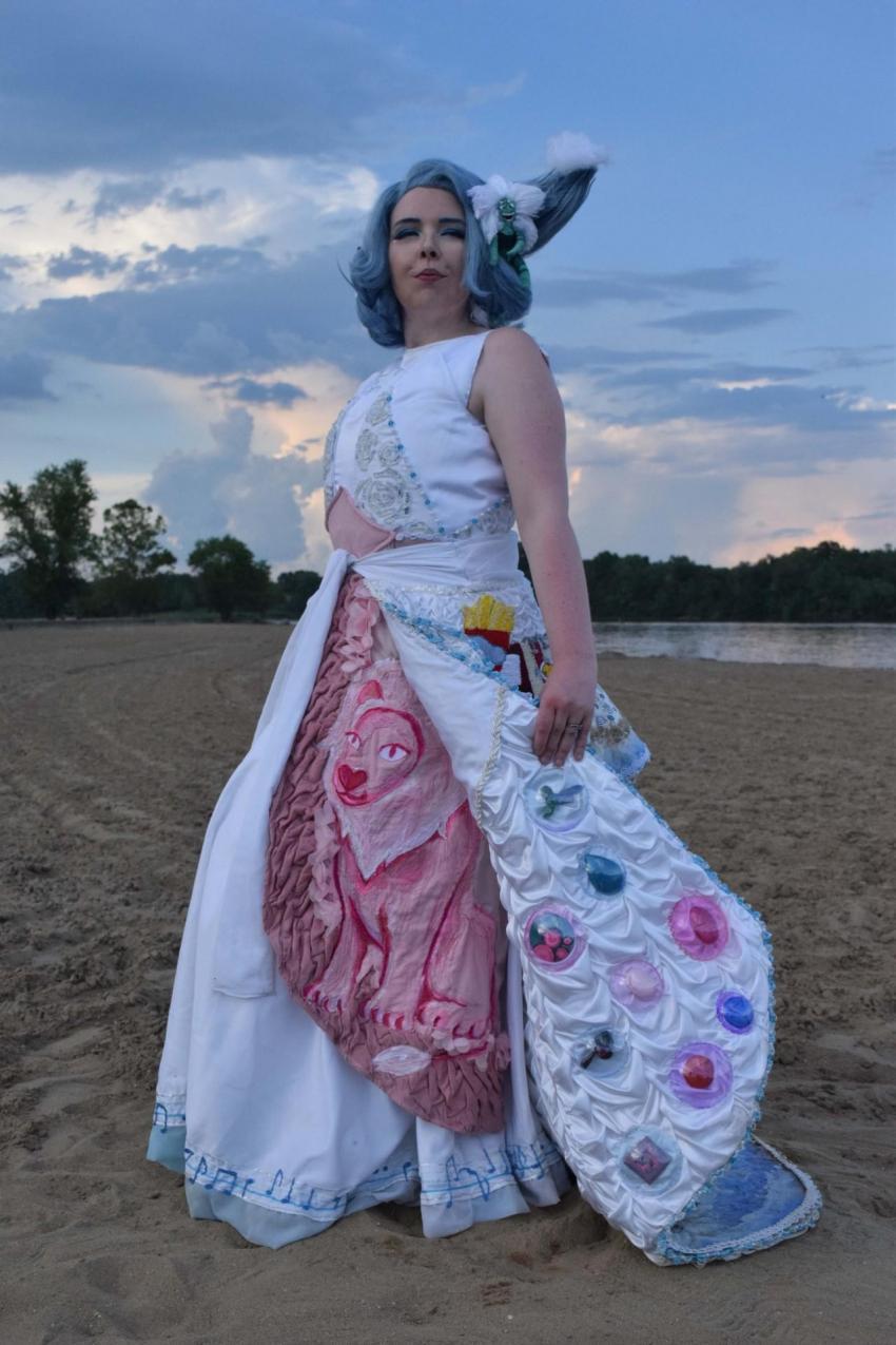 """""""Goodbye Beach City"""", a beautiful homage to Steven Universe, any way she turns, there's a detailed story sewn into her dress! From Moria Magre/MinesOfMoriaCosplays"""