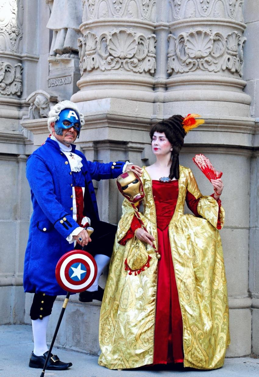 """""""Lord Captain America and Iron Lady"""", an Avengers Masquerade, cleverly imagining two Marvel heroes in refined and elegant period costuming, as crafted by Miguel and Lucy Capuchino / Capuchino Cosplay"""