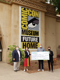 Comic-Con International staff with Cox check at Museum
